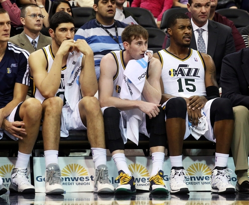 Utah Jazz's Enes Kanter, left, Utah Jazz's Gordon Hayward, middle, and Utah Jazz's Derrick Favors (15) sit on the bench late in the second half while trailing the San Antonio Spurs during an NBA basketball game on Saturday, Dec. 14, 2013, in Salt Lake City. San Antonio won the game 100-84. (AP Photo/Kim Raff)
