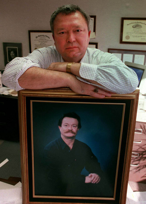 Jesse Trentadue, a Salt Lake City attorney, is shown in his office with a picture of his brother, Kenneth. Kenneth Trentadue was found hanging from a noose made of torn bed sheets in a federal prison cell on Aug. 21, 1995. The death was ruled a suicide, but Jesse Trentadue believes his brother was killed after being mistaken for an Oklahoma City bombing conspirator.    Tim Kelly