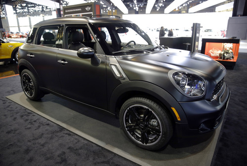 """HOLD FOR RELEASE UNTIL 12:01 A.M. EDT WEDNESDAY, JULY 30. THIS PHOTO MAY NOT BE PUBLISHED, BROADCAST OR POSTED ONLINE BEFORE 12:01 A.M. EDT WEDNESDAY - FILE - In this Feb. 7, 2014 file photo, a 2014 Mini Cooper S Countryman All4 is on display during the media preview at the Chicago Auto Show at McCormick Place in Chicago. The four-door Countryman was the only one of 12 cars to earn a """"good"""" rating in new frontal crash tests performed by the Insurance Institute for Highway Safety, an Arlington, Va.-based safety group that's funded by insurers. (AP photo/Nam Y. Huh)"""