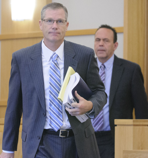 Eli Lucero  |  Pool Photo  Prosecuting attorney James Swink, front, and defense attorney David Perry return to the courtroom after meeting in the judge's chambers during the Jason Burr hearing, Wednesday, in First District Court. Burr plead guilty to three felonies from an incident when he entered the Cache Valley Hospital with loaded guns.
