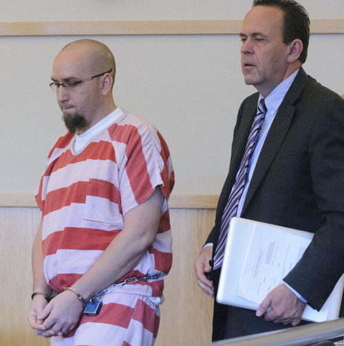 Eli Lucero  |  Pool Photo  Jason Burr, left, walks into the courtroom with his defense attorney David Perry, Wednesday, in First District Court. Burr plead guilty to three felonies from an incident when he entered the Cache Valley Hospital with loaded guns.