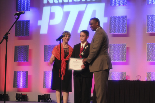 | Courtesy Photo  From left, National PTA President-elect Laura Bay, Utah student Eric Gillespie and National PTA President Otha Thornton. Eric was honored at the PTA national convention in Texas in June for his award-winning video about his father.