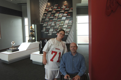 | Courtesy Gillespie Family  Eric Gillespie and his dad David Gillespie visit the Ute football training facility this summer. Eric's video about his father completing marathons despite being paralyzed won a national award in the PTA Reflections contest this year.