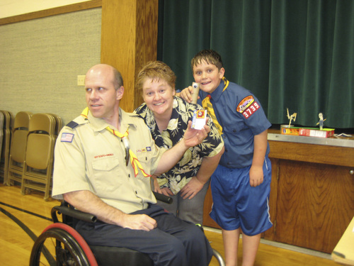 | Courtesy Gillespie Family  David Gillespie, Eden Gillespie and their son Eric Gillespie pose after Eric received a Cub Scout award in 2012. Eric's video about his father completing marathons despite being paralyzed won a national award in the PTA Reflections contest this year.