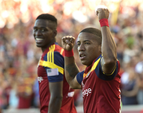 Real Salt Lake forward Jou Plata, right, celebrates his first half goal, in MLS action against the New York Red Bulls at Rio Tinto Stadium, in Salt Lake City, Wednesday, July 30, 2014.  (AP Photo/The Salt Lake Tribune, Rick Egan)  DESERET NEWS OUT; LOCAL TELEVISION OUT; MAGS OUT