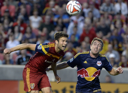 Rick Egan  |  The Salt Lake Tribune  Real Salt Lake defender Chris Wingert (17) goes after the ball along with New York Red Bulls midfielder Eric Alexander (12), in MLS action at Rio Tinto Stadium, Wednesday, July 30, 2014