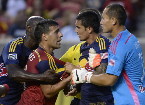 Real Salt Lake midfielder Javier Morales (11) gets mixed up with New York Red Bulls midfielder Tim Cahill (17) and New York Red Bulls goalkeeper Luis Robles (31), in MLS action at Rio Tinto Stadium, in Salt Lake City, Wednesday, July 30, 2014. (AP Photo/The Salt Lake Tribune, Rick Egan)
