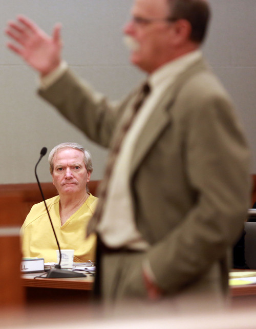 Kristin Murphy | Pool John Martin Carrell listens as defense attorney Ron Yengich speaks during the second day of a preliminary hearing in the case of State of Utah vs. John Martin Carrell in 3rd District Court in West Jordan on Thursday, July 31, 2014.