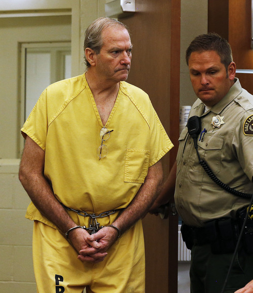 Ravell Call  |  Pool  John Martin Carrell enters the courtroom for a preliminary hearing in State of Utah vs. John Martin Carrell, 3rd District Court in West Jordan, Wednesday, July 30, 2014.