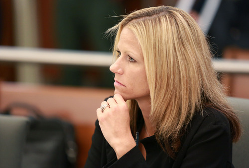 Kristin Murphy  |  Pool Andrea Hansen, Sandy police detective and case manager, listens during the second day of a preliminary hearing in the case of State of Utah vs. John Martin Carrell in 3rd District Court in West Jordan on Thursday, July 31, 2014. Carrell, a former Canyons School District bus driver, is charged with 23 counts of aggravated sexual abuse of a child involving one girl and 10 counts, one of them attempted, involving another.