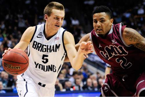 BYU's Kyle Collinsworth (5) shoots over the block of San Diego's Jito Kok (33) Brett Bailey (32) and Dennis Kramer (40) during the first half of an NCAA college basketball game on Saturday, March 1, 2014, in San Diego.  (AP Photo/Denis Poroy)