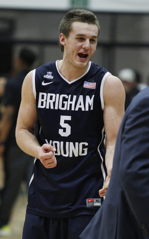 BYU's Kyle Collinsworth smiles after BYU defeated San Francisco 83-76 in an NCAA college basketball game, Thursday, Jan. 16, 2014, in San Francisco. (AP Photo/George Nikitin)