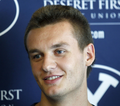 Al Hartmann     The Salt Lake Tribune BYU basketball player Kyle Collinsworth speaks with the media at BYU Tuesday July 23. He recently returned from his church mission to Russia and is expected to contribute immediately to BYU's basketball team this fall.