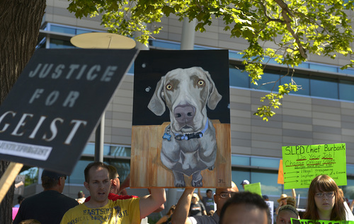 Leah Hogsten  |  The Salt Lake Tribune Marchers carried a portrait of Geist. Hundreds of supporters of Sean Kendall and his dog, Geist, who was shot and killed in his backyard by a Salt Lake City police officer during a search for a missing child, rally to protest the officer's action, Saturday, June 28, 2014 at the SLC Police headquarters.