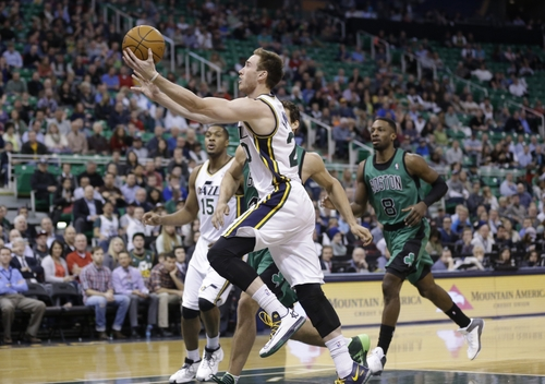 Utah Jazz's Gordon Hayward (20) plays the ball as Boston Celtics' Jeff Green (8) pursues in the first quarter of an NBA basketball game, Monday, Feb. 24, 2014, in Salt Lake City. (AP Photo/Rick Bowmer)