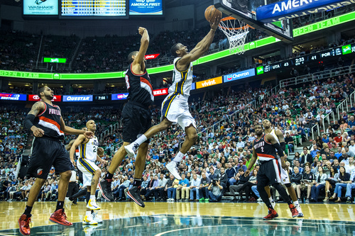Chris Detrick  |  The Salt Lake Tribune Utah Jazz guard Alec Burks (10) dunks past Portland Trail Blazers forward Nicolas Batum (88) during the game at EnergySolutions Arena Friday April 11, 2014. Portland is winning the game 53-51 at halftime.