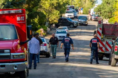 Trent Nelson  |  The Salt Lake Tribune Police and firefighters at the scene of an investigation into the apparent beating death of a 70-year-old Millcreek man, Friday August 1, 2014.