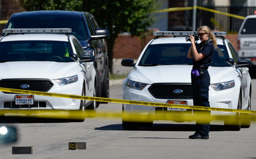 Francisco Kjolseth  |  The Salt Lake Tribune Unified Police investigate the scene where one of their officers shot an armed man in Taylorsville on Friday morning, Aug 1, 2014. The man with the gun outside a residence at 5514 S. Ridgecrest (3400 West) was shot at least once and is reported in serious condition.