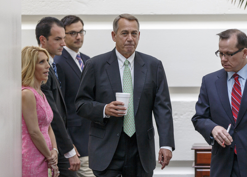 House Speaker John Boehner of Ohio arrives for a closed-door meeting of House Republicans on Capitol Hill in Washington, Friday, Aug. 1, 2014, to deal with the border crisis, a day after Congress was supposed to go into its August recess. (AP Photo/J. Scott Applewhite)