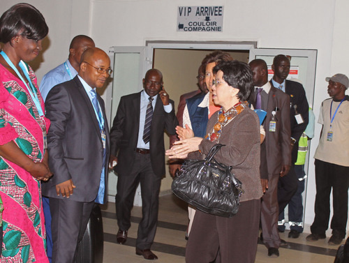 China's Margaret Chan, center, Director-General of the World Health Organization, WHO, is greeted by officials as she arrives at the airport for talks on Ebola in the city of Conakry, Guinea, Friday, Aug. 1, 2014. The death toll from the worst recorded Ebola outbreak in history surpassed 700 in West Africa as security forces went house-to-house in Sierra Leone's capital Thursday looking for patients and others exposed to the disease. Fears grew as the United States warned against travel to the three infected countries — Guinea, Sierra Leone and Liberia — and Sierra Leone's soccer team was blocked from boarding a plane in Nairobi, Kenya, that was to take them to the Seychelles for a game on Saturday. (AP Photo/ Youssouf Bah)