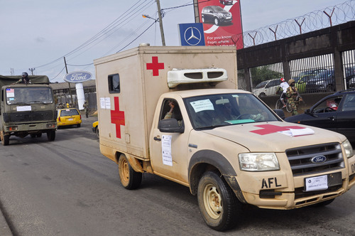 Liberian soldiers in a medical truck, with papers on it reading 'EBOLA MOST GO'  drive past as they patrol streets to prevent panic, as fears of the deadly Ebola virus spread in the city of Monrovia, Liberia, Friday, Aug 1, 2014. U.S. health officials warned Americans not to travel to the three West African countries hit by the worst recorded Ebola outbreak in history. The travel advisory issued Thursday applies to nonessential travel to Guinea, Liberia and Sierra Leone, where the deadly disease has killed more than 700 people this year. (AP Photo/Abbas Dulleh)