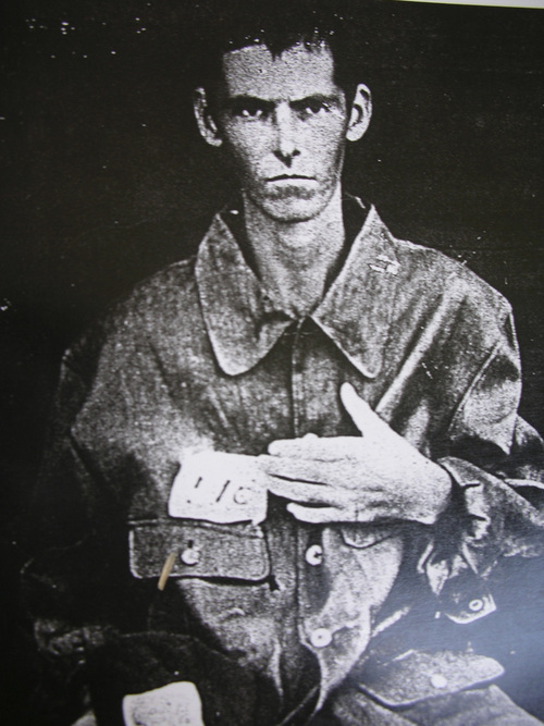 | Courtesy  Kruger family  The Japanese military took this photo to log Courtney Kruger into a prison camp. Kruger spent 3 1/2 years as a prisoner during World War II.