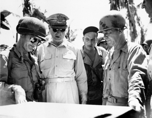From left to right, Lt. Gen. George C. Kenney, Gen. Douglas MacArthur, Maj. Gen. James L. Bradley, and Maj. Gen. Richard Sutherland are seen at the 96th Army Division headquarters in Leyte, the Philippines, during World War II in 1944.  (AP Photo/Stanley Troutman/Acme War Picture Pool)