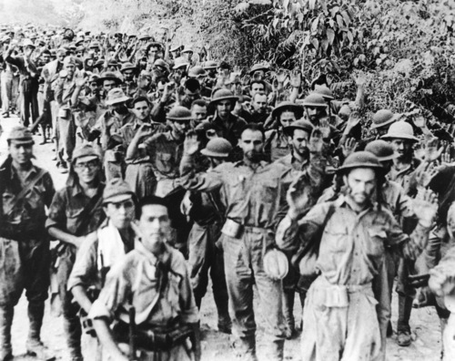 U.S. soldiers surrender to the Japanese forces at an unknown location in the Philippines, on August 12, 1942, during the Japanese invasion in World War II. (AP Photo)