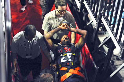 In this photo provided by the Las Vegas News Bureau,  Indiana Pacers' Paul George is carted off the court after breaking his right leg during the USA Basketball Showcase intrasquad game in Las Vegas on Friday, Aug. 1, 2014. (AP Photo/Las Vegas News Bureau, Glenn Pinkerton)
