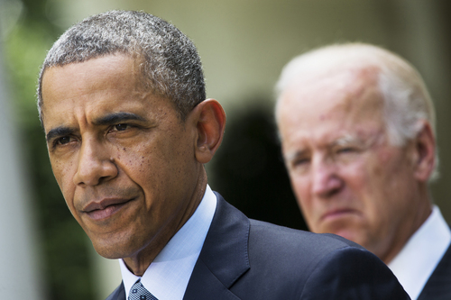 FILE - This June 30, 2014 file photo shows President Barack Obama, accompanied by Vice President Joe Biden, pausing while making a statement about immigration reform, in the Rose Garden of the White House in Washington. What can Obama actually do without Congress to change U.S. immigration policies? A lot, it turns out.  (AP Photo/Jacquelyn Martin, File)