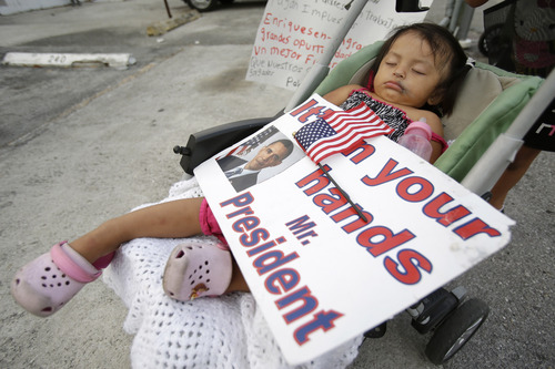 FILE - This April 30, 2014, file photo shows Diana Jimenez, 2, as she sleeps in a stroller during a rally sponsored by local immigrant rights organizations, in Homestead, Fla. Jimenez's father was deported to Guatemala two years ago leaving Jimenez and four siblings in the U.S. What can President Barack Obama actually do without Congress to change U.S. immigration policies? A lot, it turns out. (AP Photo, File)