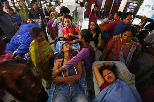 Landslide victims wait for treatment at a hospital in Katmandu, Nepal, Saturday, Aug. 2, 2014. A massive landslide killed at least eight people and blocked a mountain river in northern Nepal on Saturday, causing the water to form a lake that was threatening to burst and sweep several villages, officials said. (AP Photo/Niranjan Shrestha)