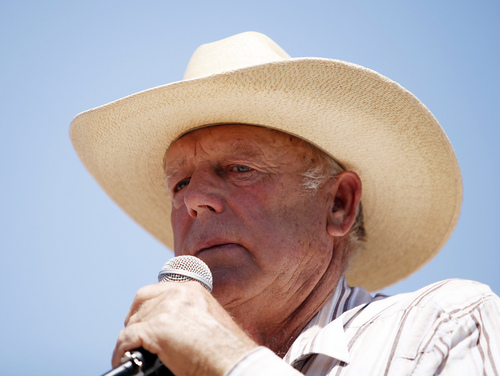 FILE - In this April 24, 2014, file photo, rancher Cliven Bundy speaks at a news conference near Bunkerville, Nev. Bundy claims the April confrontation between the federal government and his armed supporters was part of an age-old spiritual battle between good and evil. Bundy, a Mormon, told an Independent American Party gathering in St. George, Utah, on Saturday, Aug. 2, 2014 that God provided him personal inspiration in the showdown over cattle in Bunkerville, Nevada, about 80 miles northeast of Las Vegas. (AP Photo/Las Vegas Review-Journal, John Locher, File)