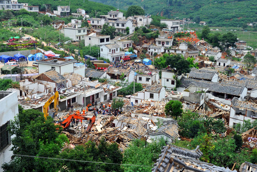 Collapsed houses are seen in Ludian County of Zhaotong City in southwest China's Yunnan Province, Monday, Aug. 4, 2014, following Sunday's strong earthquake.  Rescuers dug through shattered homes Monday looking for survivors of the strong earthquake in southern China's Yunnan province that killed hundreds and injured more than a thousand people. (AP Photo/Kyodo News) JAPAN OUT