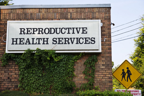 In this Wednesday, July 30, 2014 photo, Reproductive Health Services is shown, in Montgomery, Ala. Reproductive Health Services is the only abortion clinic in Montgomery and an Alabama law restricting doctors at abortion clinics was ruled unconstitutional because it would unduly hamper women's ability to obtain the medical procedure, a judge said Monday, Aug. 4, 2014. (AP Photo/Brynn Anderson)