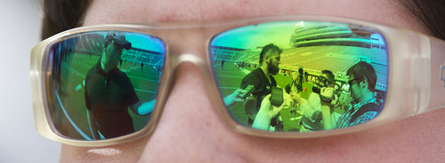 Steve Griffin  |  The Salt Lake Tribune  Utah defensive back Brian Blechen is reflected in a reporter's sunglasses as he talks with the media after football practice at Rice-Eccles Stadium in Salt Lake City Monday, Aug. 4, 2014.