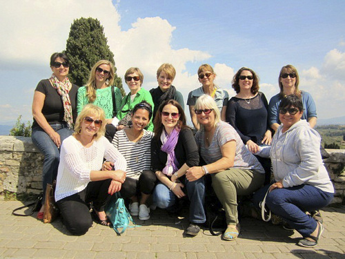 """(Courtesy photo)  Former Salt Lake City resident Lisa Condie, center back, and Sarah Walton, center front, have formed a tour company in Italy, where Condie now lives. The 10 other women joined them last April for their first tour. Condie is being celebrated by Huffington Post and the Today show as one of """"50 Over 50,"""" people who have reinvented their lives after age 50."""