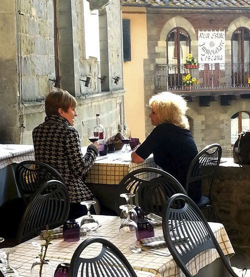 """(Courtesy photo)  Former Salt Lake City resident Lisa Condie, left, is co-owner of a tour company in Italy, where she now lives. She's with a friend in this photos. Condie is being celebrated by Huffington Post and the Today show as one of """"50 Over 50,"""" people who have reinvented their lives after age 50."""