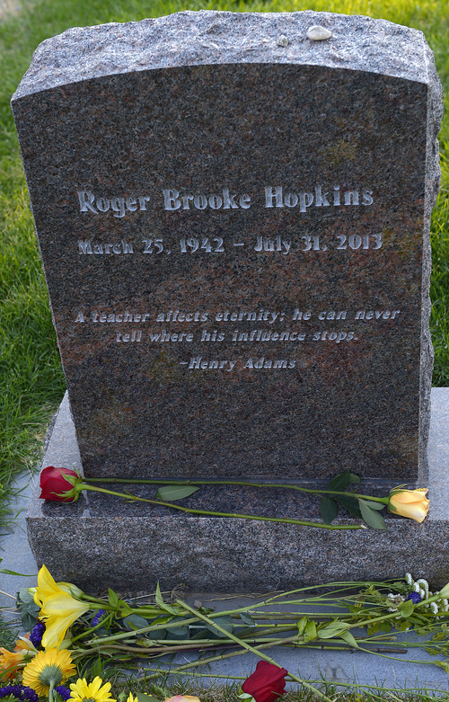 Leah Hogsten     The Salt Lake Tribune Poetry from Henry Adams graces Brooke Hopkins' headstone. Peggy Battin and friends read poetry and tell loving stories of her husband Brooke Hopkins' July 30, 2014 in the Salt Lake City Cemetery on the eve of the one-year anniversary of his passing. Hopkins battled through pain after a paralyzing 2008 bicycle injury to keep writing, resume teaching while enduring constant pain, infections and setbacks.