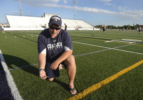 Al Hartmann  |  The Salt Lake Tribune  Corner Canyon High School football coach Donald Eck likes the new articial turf on the school's football field.