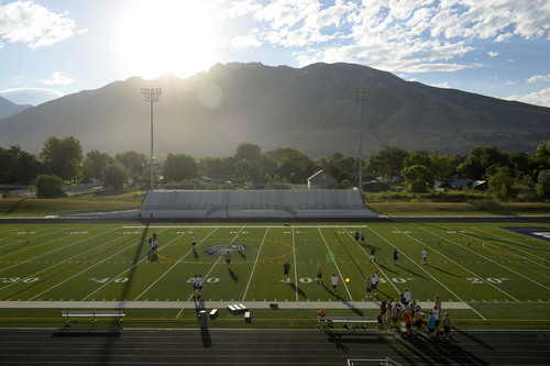 Al Hartmann  |  The Salt Lake Tribune  Sunrises over the mountain onto Corner Canyon High School's football field with new artificial turf.