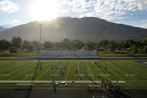 Al Hartmann  |  The Salt Lake Tribune  Sunrises over the mountain onto Corner Canyon High School's football field with new artificial turf.