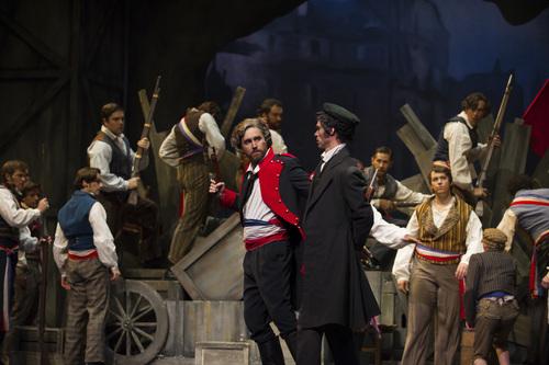 Patrick Miller as Jean Valjean (in red and blue coat) and Daniel Cilli as Javert (in cap) in Les Miserables. Courtesy Utah Festival Opera & Musical Theater