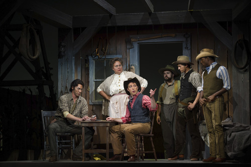 Courtesy Photo  Lead characters, from left, Kevin Nakatani as Jud Fry, Vanessa Schukis as Aunt Eller and Wes Mason as Curly, with cowboys from the ensemble.