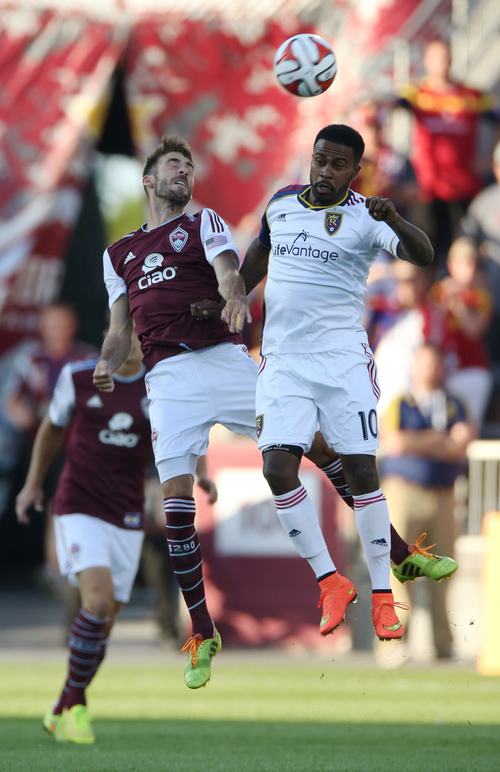 Colorado Rapids midfielder Jose Mari, left, and Real Salt Lake forward Robbie Findley go up for a head ball in the first half of a Major League Soccer game in Commerce City, Colo., on Saturday, Aug. 2, 2014. (AP Photo/David Zalubowski)