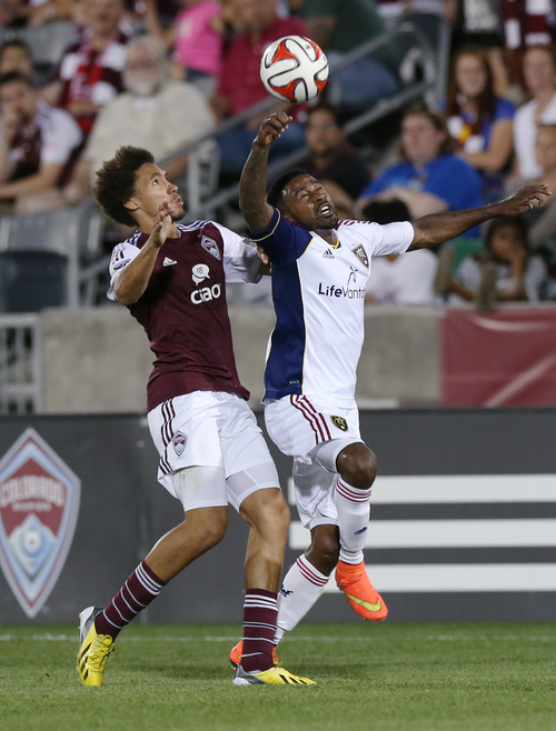 Colorado Rapids defenseman Christopher Klute, left, pursues ball with Real Salt Lake forward Robbie Findley in the second half of Salt Lake's 1-0 victory in an MLS soccer game in Commerce City, Colo., on Saturday, Aug. 2, 2014. (AP Photo/David Zalubowski)