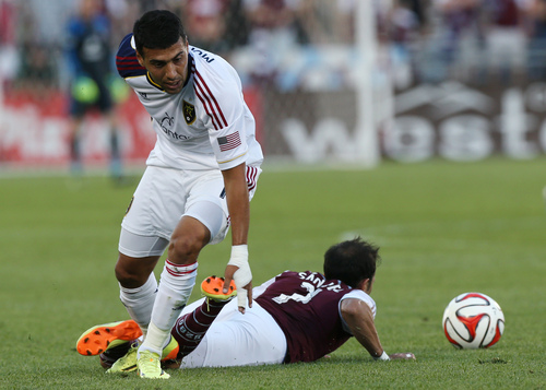 Real Salt Lake midfielder Javier Morales, left, gets tangled up with Colorado Rapids forward Vicente Sanchez in the first half of an MLS soccer game in Commerce City, Colo., on Saturday, Aug. 2, 2014. (AP Photo/David Zalubowski)