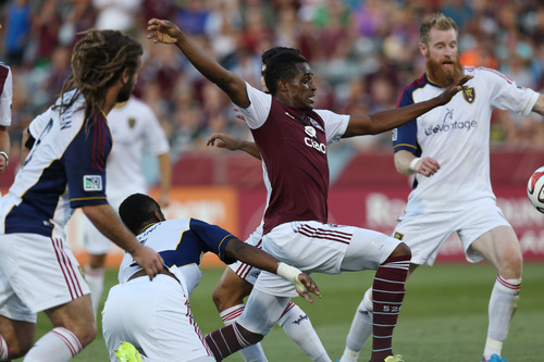 Colorado Rapids forward Deshorn Brown, second from right, tries to kick ball in for goal as, from left, Real Salt Lake's Kyle Beckerman, Aaron Maund and Nat Borchers defend during the first half of an MLS soccer game in Commerce City, Colo., on Saturday, Aug. 2, 2014. (AP Photo/David Zalubowski)
