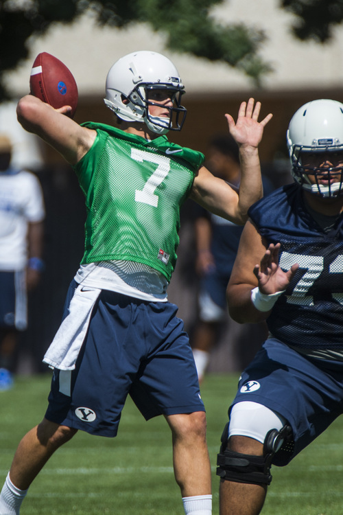 Chris Detrick  |  The Salt Lake Tribune Brigham Young Cougars quarterback Christian Stewart (7) during a practice at Richards Building Fields Friday August 1, 2014.
