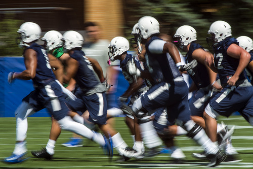 Chris Detrick  |  The Salt Lake Tribune Brigham Young Cougars run during a practice at Richards Building Fields Friday August 1, 2014.